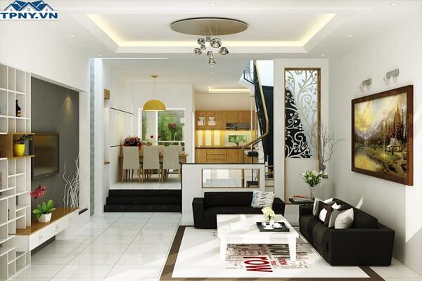 Không gian phòng khách như được mở rộng hơn với kiểu thiết kế liên thông phòng bếp